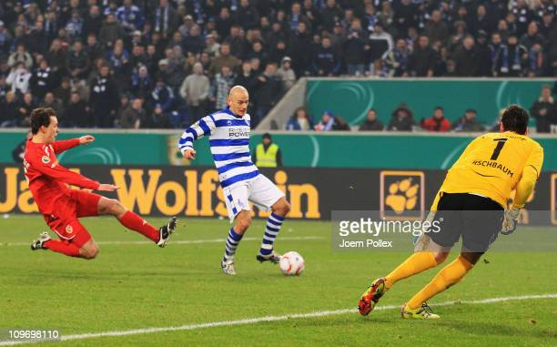 Srdjan Baljak of Duisburg scores his team's second goal during the DFB Cup semi final match between MSV Duisburg and Energie Cottbus at...