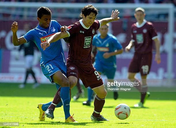 Srdjan Lakic of Kaiserslautern battles for the ball with Luiz Gustavo of Hoffenheim during the Bundesliga match between 1FC Kaiserslautern and TSG...