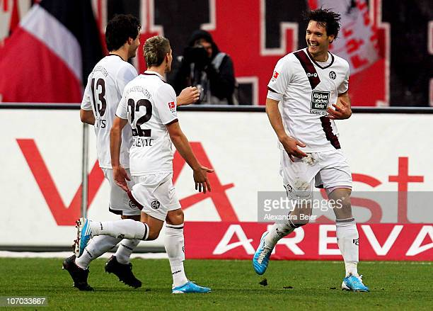 Srdjan Lakic of Kaiserslautern celebrates his first goal together with his team mates Thanos Petsos and Ivo Ilicevic during the Bundesliga match...