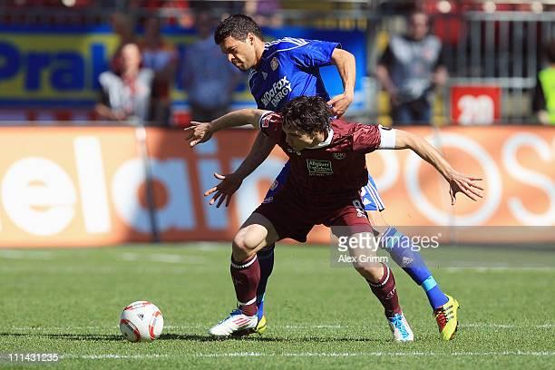 Srdjan Lakic of Kaiserslautern is challenged by Michael Ballack of Leverkusen during the Bundesliga match between 1. FC Kaiserslautern and Bayer...