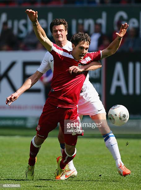 Srdjan Lakic of Kaiserslautern is held by Marcel Matritz of Bochum during the Second Bundesliga match between 1 FC Kaiserslautern and VfL Bochum at...