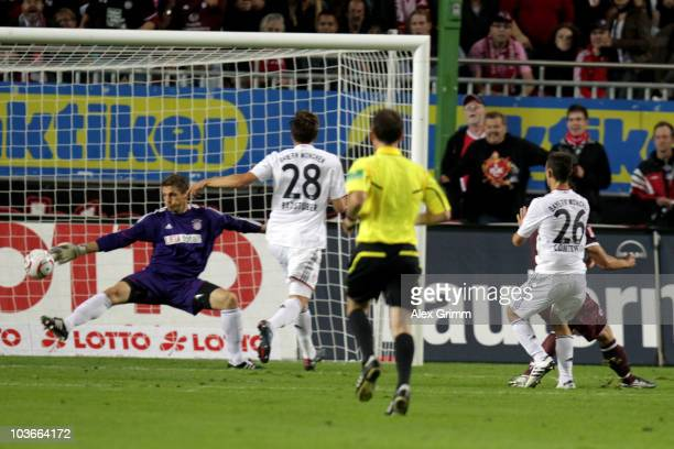 Srdjan Lakic of Kaiserslautern scores his team's second goal against Diego Contento Holger Badstuber and goalkeeper Hans Joerg Butt of Muenchen...