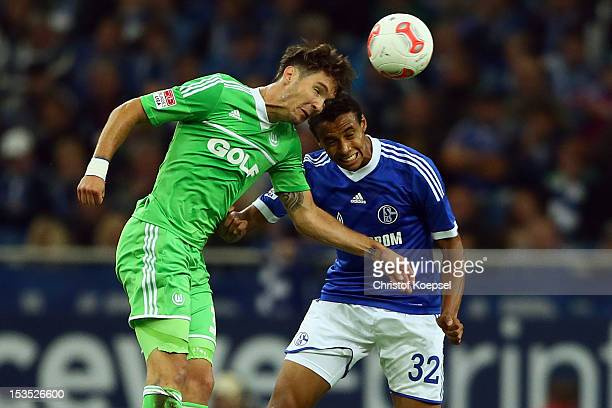 Srdjan Lakic of Wolfsburg and Joel Matip of Schalke go up for a header during the Bundesliga match between FC Schalke 04 and VfL Wolfsburg at...
