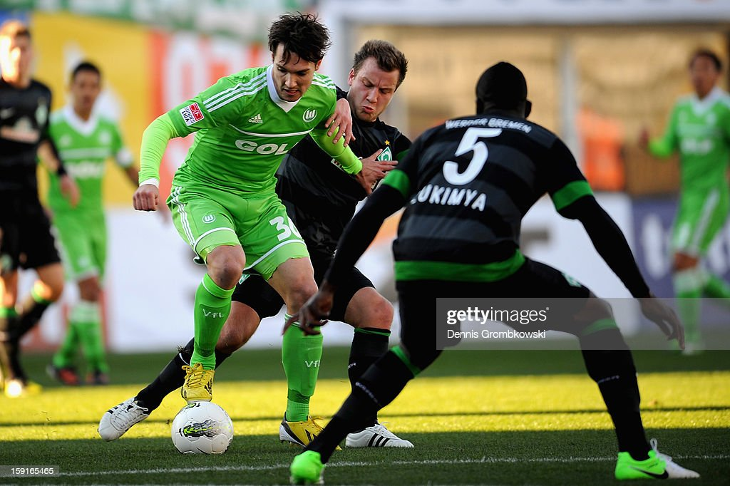 Srdjan Lakic of Wolfsburg is challenged by Philipp Bargfrede of Bremen during the friendly match between Werder Bremen and VfL Wolfsburg at Mardan Palace Stadium on January 9, 2013 in Kundu, Turkey.