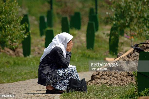 A Bosnian Muslim woman prays 09 July 2005 at the memorial for the victims of the July 1995 massscre in Srebrenica just outside the eastern Bosnian...