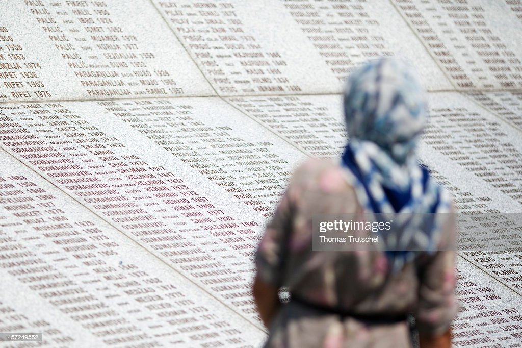 Srebrenica Memorial, a woman in front of a stone tablet with the names of those murdered on August 07, 2011, in Srebrenica, Bosnia and Herzegovina. In July 2005, Serbian units under General Ratko Mladic killed about 8000 Muslims here.