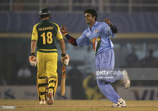 Sreekanth Sreesanth of India celebrates the wicket of Australian opener Adam Gilchrist during the ICC Champions Trophy match between Austalia and...