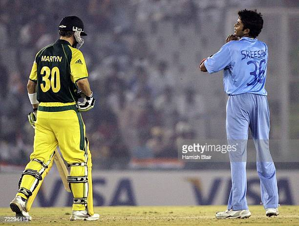 Sreekanth Sreesanth of India who's shirt has his name and number handwritten on it exchanges words with Damien Martyn of Australia during the ICC...