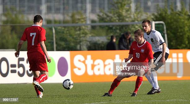 Sören Bertram of Germany battles for the ball with Marco Stiepermann and Adrian Blad of Poland during the U19 Championship Elite Round match between...