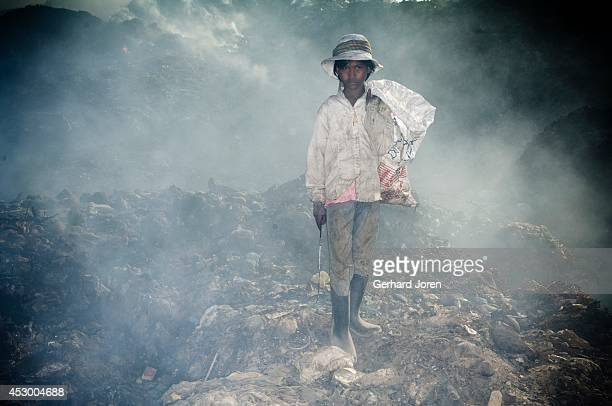 Srey Mau works all day at the dump but she would rather study She helps to support her three brothers and five sisters She has found all her clothes...