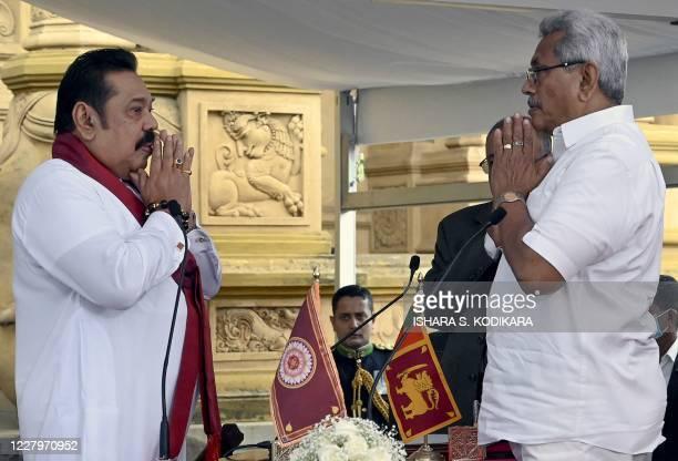 Sri Lakan President Gotabaya Rajapaksa prays before he swears in his elder brother Mahinda Rajapaksa as Sri Lanka's new Prime Minister at the sacred...