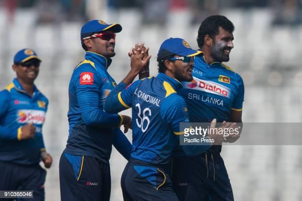 Sri Lanka all rounder Thisara Perera and Dinesh Chandimal along with Danushka Gunathilaka celebrating the last wicket of Bangladesh team during the...
