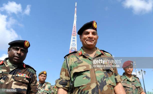 Sri Lanka army chief Jagath Jayasuriya inspects a rebuilt communication tower in the northern town of Kokavil on April 8 2011 The tower was earlier...