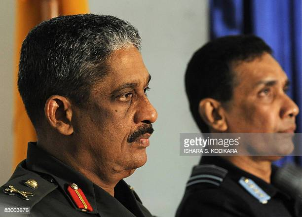 Sri Lanka army chief Lieutenant General Sarath sits next to the island's airforce commander Air Vice marshal Roshan Goonatilake during a book launch...