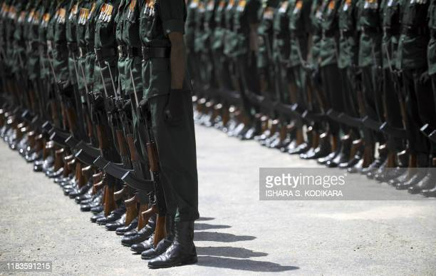 Sri Lanka army commandos stand to attention during a farewell ceremony for outgoing Army Chief General Sarath Fonseka at army headquarters in Colombo...