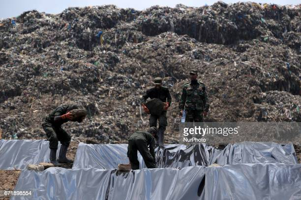Sri Lanka Army personnel cover the site of the collapsed garbage mountain with black colored polythene at Meetotamulla in Colombo Sri Lanka 23 April...