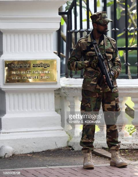 A Sri Lanka Army soldier stands guard at the prime minister's office in Colombo on October 29 2018 Ousted prime minister Ranil Wickremesinghe said on...