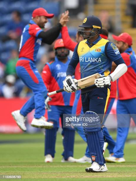 Sri Lanka batsman Angelo Mathews leaves the field after being dismissed by Afghanistan bowler Mohammad Nabi during the Group Stage match of the ICC...