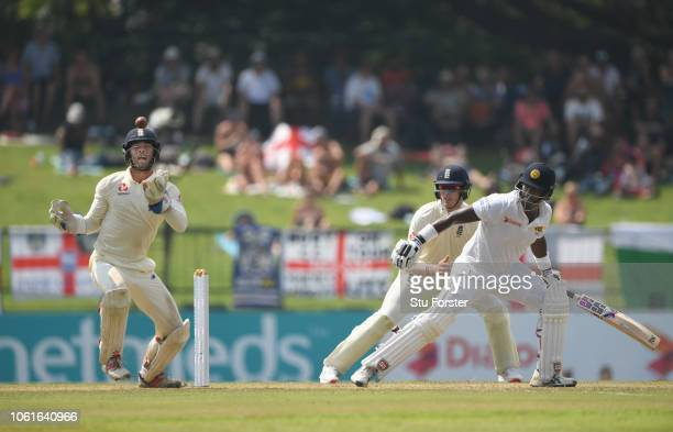 Sri Lanka batsman Angelo Matthews is caught by Ben Foakes at the second attempt off the bowling of Adil Rashid during Day Two of the Second Test...