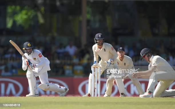Sri Lanka batsman Dhananjaya de Silva reacts as England fielder Keaton Jennings takes a catch to dismiss the batsman on 73 runs during Day Two of the...