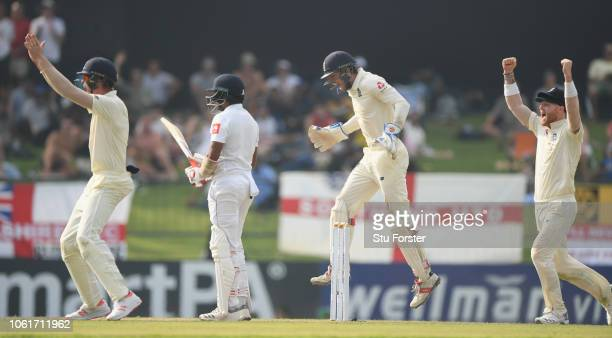Sri Lanka batsman Dilruwan Perera is dismissed by Jack Leach as Ben Foakes and the England close fielders appeal with success during Day Two of the...
