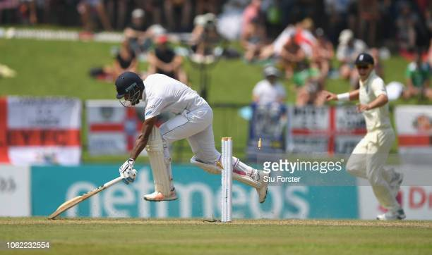 Sri Lanka batsman Dimuth Karunaratne is run out by a direct throw from Ben Stokes for 63 runs during Day Two of the Second Test match between Sri...