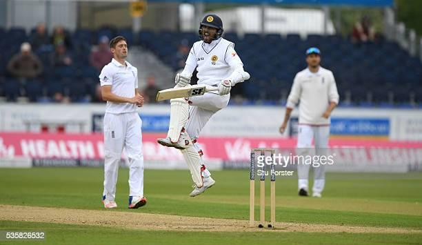 Sri Lanka batsman Dinesh Chandimal celebrates his century during day four of the 2nd Investec Test match between England and Sri Lanka at Emirates...