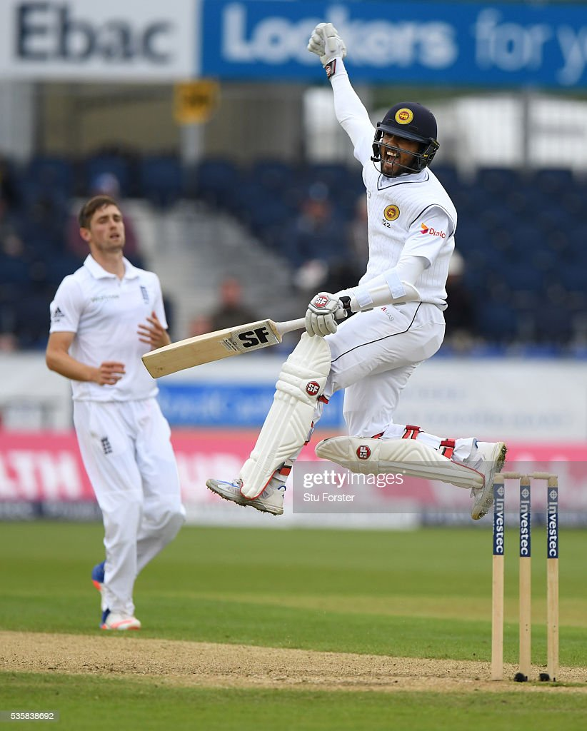 Sri Lanka batsman Dinesh Chandimal celebrates his century during day four of the 2nd Investec Test match between England and Sri Lanka at Emirates Durham ICG on May 30, 2016 in Chester-le-Street, United Kingdom.
