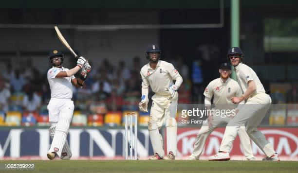 Sri Lanka batsman Kusal Mendis hits a six off Moeen Ali as Ben Foakes and the close fielders look on during Day Four of the Third Test match between...