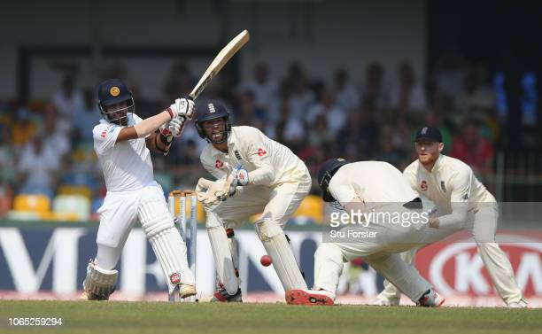 Sri Lanka batsman Kusal Mendis hits out off Moeen Ali as Keaton Jennings takes cover during Day Four of the Third Test match between Sri Lanka and...