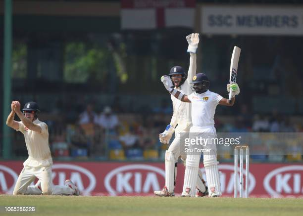 Sri Lanka batsman Niroshan Dickwella reacts as short leg fielder Keaton Jennings takes the catch during Day Four of the Third Test match between Sri...