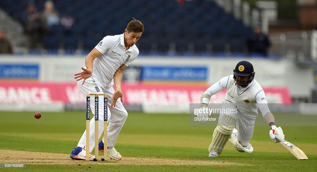 Sri Lanka batsman Rangana Herath makes his ground as England bowler Chris Woakes reacts during day four of the 2nd Investec Test match between England and Sri Lanka at Emirates Durham ICG on May 30, 2016 in Chester-le-Street, United Kingdom.