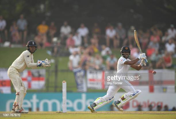 Sri Lanka batsman Roshen Silva cuts the ball for some runs watched by Ben Foakes during Day Two of the Second Test match between Sri Lanka and...