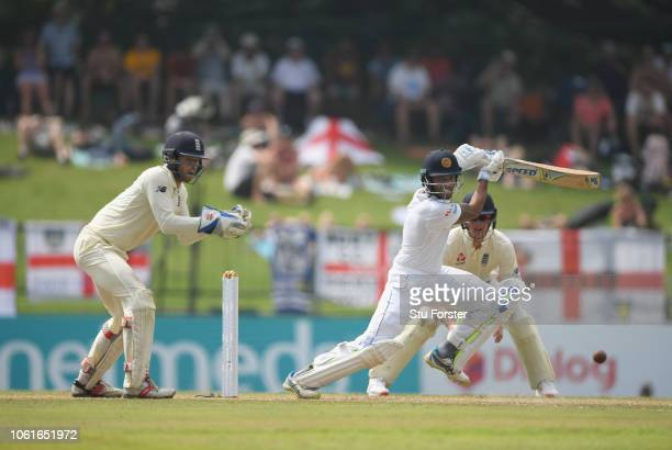 Sri Lanka batsman Roshen Silva drives as Ben Foakes looks on during Day Two of the Second Test match between Sri Lanka and England at Pallekele...