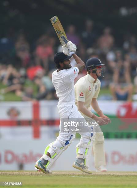 Sri Lanka batsman Roshen Silva hits out as Keaton Jennings look on during Day Two of the Second Test match between Sri Lanka and England at Pallekele...