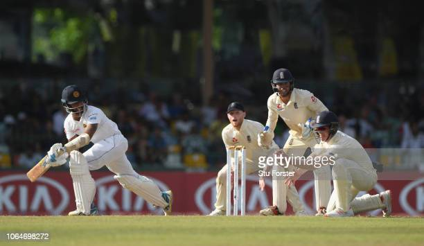 Sri Lanka batsman Roshen Silva reacts as England fielder Keaton Jennings takes a catch to dismiss the batsman off the bowling of Adil Rashid during...