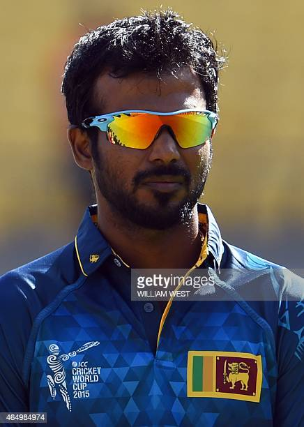 Sri Lanka batsman Upul Tharanga stands for the national anthem before the start of the England versus Sri Lanka 2015 Cricket World Cup Group A match...