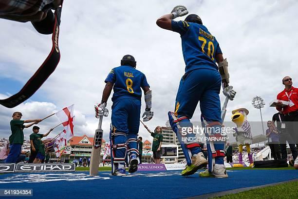 Sri Lanka batsmen Danushka Gunathilaka and Kusal Perera walk out to bat at the start of play in the first one day international cricket match between...