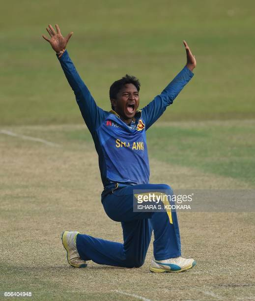 Sri Lanka Board President's XI cricketer Akila Dananjaya celebrates after dismissing Bangladesh cricketer Shuvagata Hom during the one day warmup...