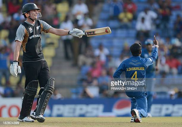 Sri Lanka bowler Akila Dananjaya celebrates the wicket of New Zealand cricketer Rob Nicol during the ICC Twenty20 Cricket World Cup's Super Eight...