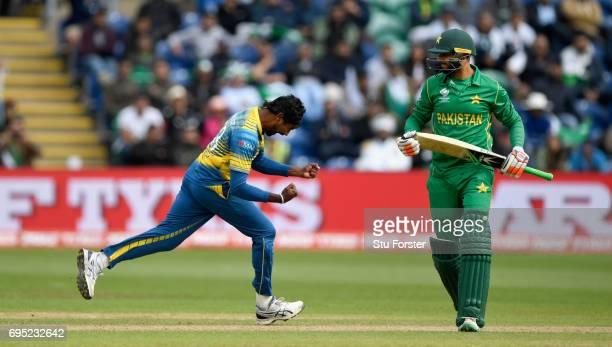 Sri Lanka bowler Nuwan Pradeep celebrates after dismissing Pakistan batsman Imad Wasim during the ICC Champions League match between Sri Lanka and...
