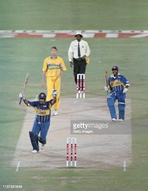 Sri Lanka captain Arunja Ranatunga celebrates with Aravinda De Silva as Australia bowler Glen McGrath looks on as Sri Lanka win the 1996 ICC Cricket...