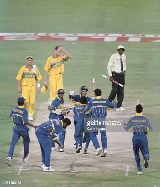 Sri Lanka captain Arunja Ranatunga celebrates with fellow batsman Aravinda De Silva and team mates whilst Shane Warne and Glen McGrath react as...