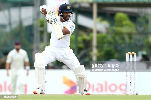 Sri Lanka captain Dimuth Karunaratne hits out during the day two of the Second Test match between Sri Lanka and New Zealand at Paikiasothy...