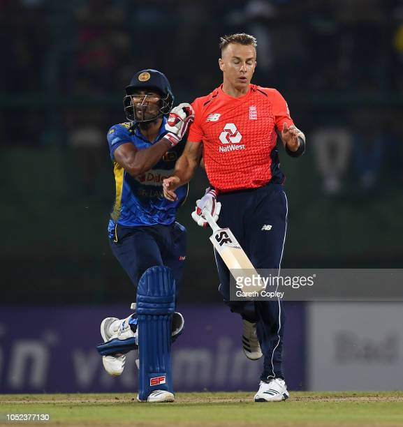 Sri Lanka captain Dinesh Chandimal collides with Tom Curran of England during the 3rd One Day International match between Sri Lanka and England at...