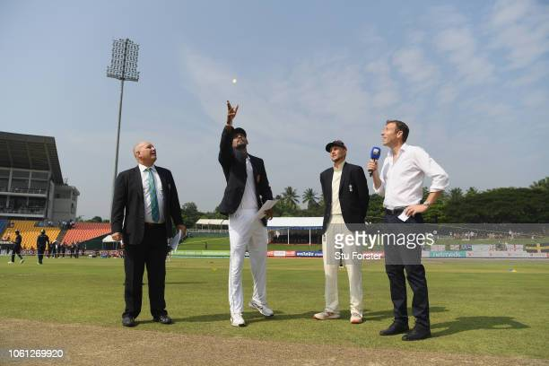 Sri Lanka captain Suranga Lakmal tosses the coin as Joe Root looks on during Day One of the Second Test match between Sri Lanka and England at...