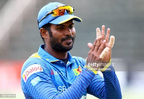 Sri Lanka captain Upul Tharanga celebrates his team's good bowling innings during the opening match of an ODI series Sri Lanka vs Zimbabwe in Harare...