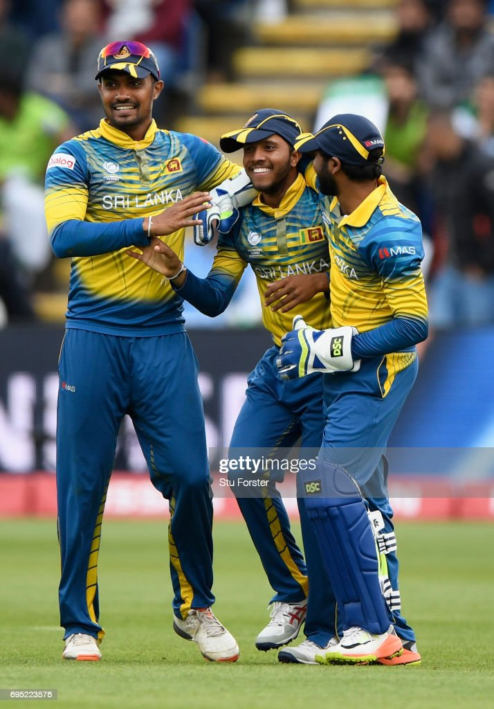 Sri Lanka catcher Kusal Mendis (c) is congratulated after dismissing Azhar Ali during the ICC Champions League match between Sri Lanka and Pakistan at SWALEC Stadium on June 12, 2017 in Cardiff, Wales.
