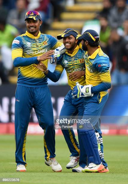 Sri Lanka catcher Kusal Mendis is congratulated after dismissing Azhar Ali during the ICC Champions League match between Sri Lanka and Pakistan at...