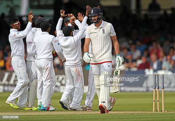 Sri Lanka celebrate as England's James Vince is bowled first ball by Nuwan Pradeep during day three of the 3rd Investec Test match between England...